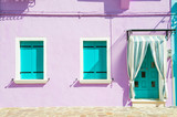 Fototapety House with purple walls and turquoise windows.