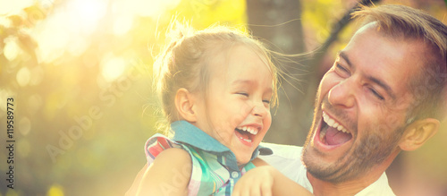 Happy joyful young father with his little daughter