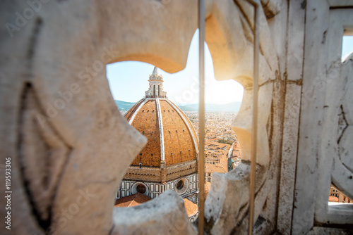 View through the gothic rose window on Duomo cathdral in Florence