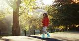 Girl having fun outdoors with umbrella