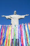 Rio Carnival celebration features colorful streamers known as lembranca at statue of Corcovado