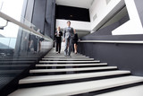 Business people on stairs