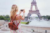 tourist taking photo of Eiffel tower in Paris with compact camera or smartphone, travel in Europe - 119631121