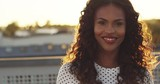 Young black african american woman smiling to the camera in sunset