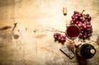 Red wine with grapes and corks.