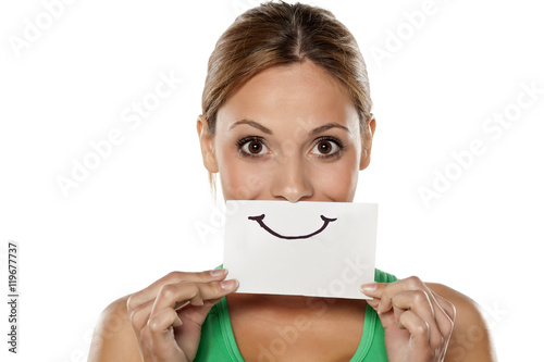 Plakát happy young woman with emotions drawn on a piece of paper