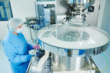 Pharmaceutics. Pharmaceutical worker operates tablet blister packaging machine