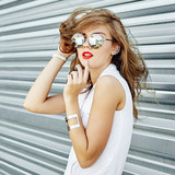 Fashion portrait of stylish girl in sunglasses