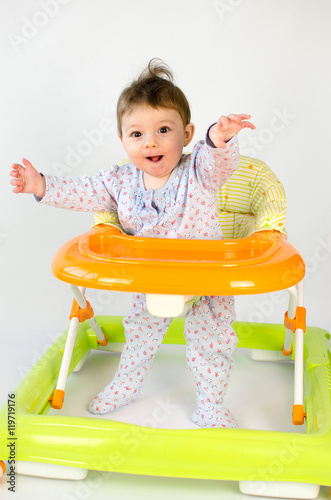 Poster baby girl in a walker