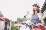 Riding lifestyle. Outdoor portrait of pretty young woman in hat