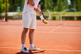 Tennis player serving on court