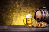 Mug of beer with foam and barrel - 119757322