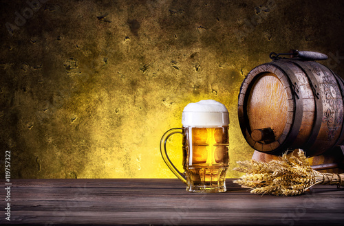 Mug of beer with foam and barrel Poster