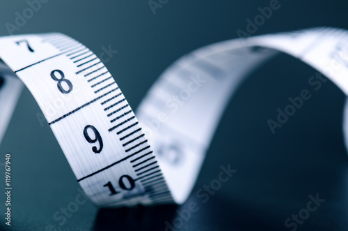 Poster White measuring tape on a dark background