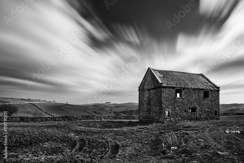 Stunning long exposure black and white landscape of derelict bar Plakát