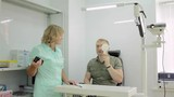 Man having her eyes examined by an eye doctor