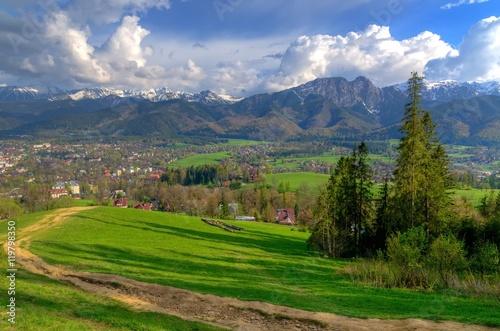 Beautiful spring mountain and rural landscape. View on the Tatra Mountains and Zakopane Town and Koscielisko Village in Poland.