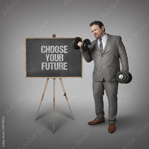 Poster Choose your future text on blackboard with businessman