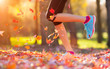 Close up of feet of a runner running in leaves