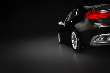 Modern black metallic sedan car in spotlight. Generic desing, brandless.