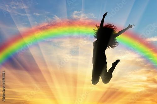 Póster Happy woman jumping near rainbow