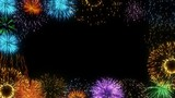 Colorful fireworks exploding in the night sky with copy space for text - seamless loop