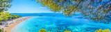 Famous adriatic beach panorama. / Famous adriatic beach Golden Horn (Zlatni Rat) in Bol, Island of Brac, Croatia summertime panorama.
