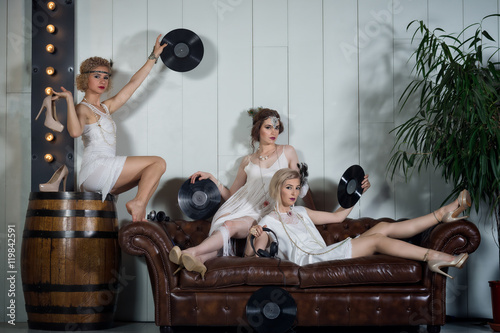 Lovely girls dressed in flapper style outfits Poster