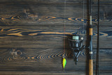 fishing tackle on a wooden table. toned image. place for the text - 119844784