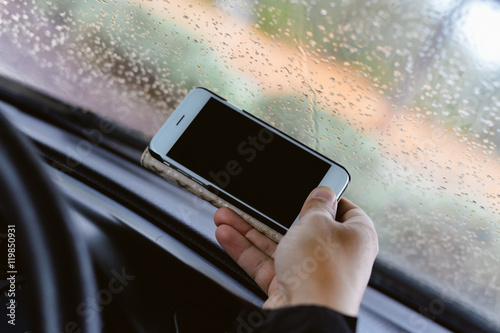Hand hold use phone in car closeup Poster