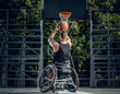 Cripple basketball player in wheelchair plays basketball.