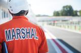 Motorsport track marshall racing bib close up