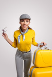 Vintage woman with yellow suitcase. travrel concept