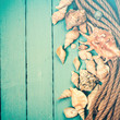 Quadro Concept of the summer time with sea shells on the wooden blue background