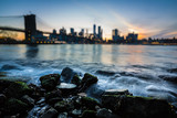 Blurred Manhattan skyline with Brooklyn Bridge