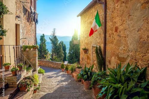 Fototapeta Small Mediterranean town - lovely Tuscan stree