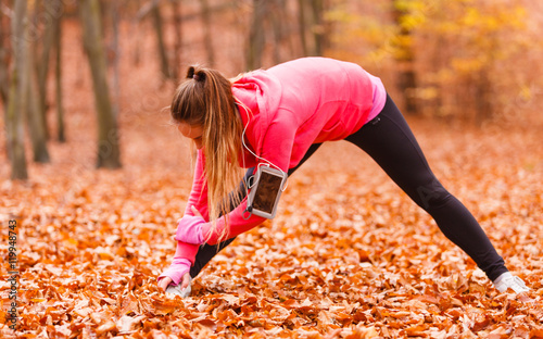 Woman exercising in the forest