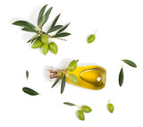 Olives with leaves and olive oil, above view.