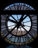 View through d'orsay museum clock tower of Sacre-Coeur Basilica.