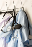 Doctors work tools: lab coat and stethoscope