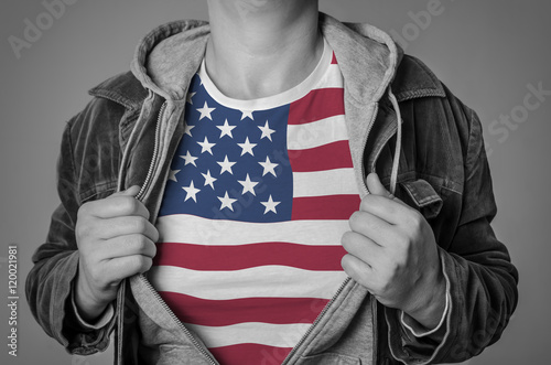 Man showing American flag on t-shirt. Concept for patriotism, fr Poster