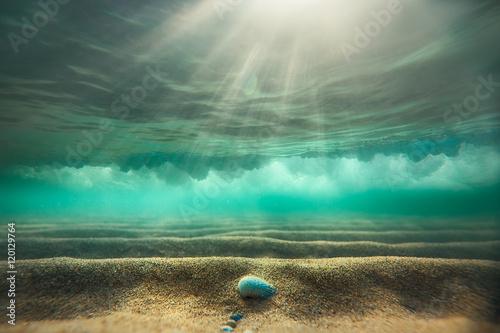 Fototapeta Underwater background with sandy sea bottom