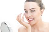 The woman applies eye contour cream - 120132760