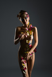 Nude girl poses with body decorated butterflies