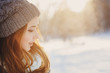 beautiful young woman relaxing on winter walk in snowy forest, candid capture, lifestyle scene