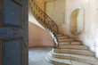 Abandoned villa with spiral staircase