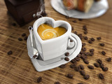 Latte and coffee beans in a heart shape cup
