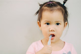 1 year 9 months baby brushing her teeth. Dental care activity for tooth & gums : Selective focus.