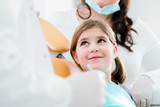 Dentist trearing child in his surgery