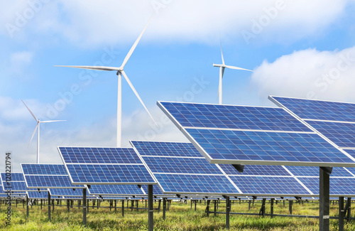 Leinwanddruck Bild solar photovoltaics  panel and wind turbines generating electricity green energy renewable